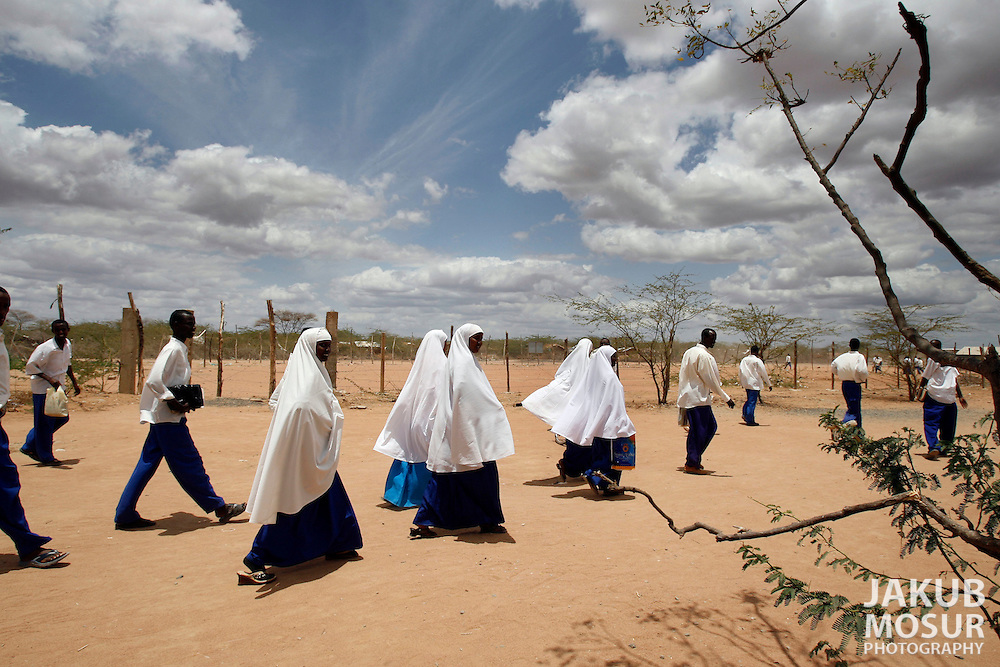 September 12, 2006 - Somali students walk home after school at the Dagahaley Refugee Camp in Dadaab, Kenya, 50 miles from the Somali border. Somalis are fleeing from recent clashes between Somalia Union of Islamic Courts and Somali warlords. Over 21,000 refugees since January 2006 have arrived in Dadaab which has a growing population of 140,000 refugees, in the North Eastern province of Kenya..(Photo by Jakub Mosur/Polaris)