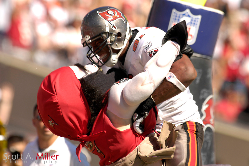 Oct. 15, 2006; Tampa, FL, USA;  Tampa Bay Buccaneers tight end (81) Alex Smith celebrates a touchdown with Captain Fear during the second half of the Bucs 14-13 win over the Cincinnati Bengals at Raymond James Stadium. ...©2006 Scott A. Miller