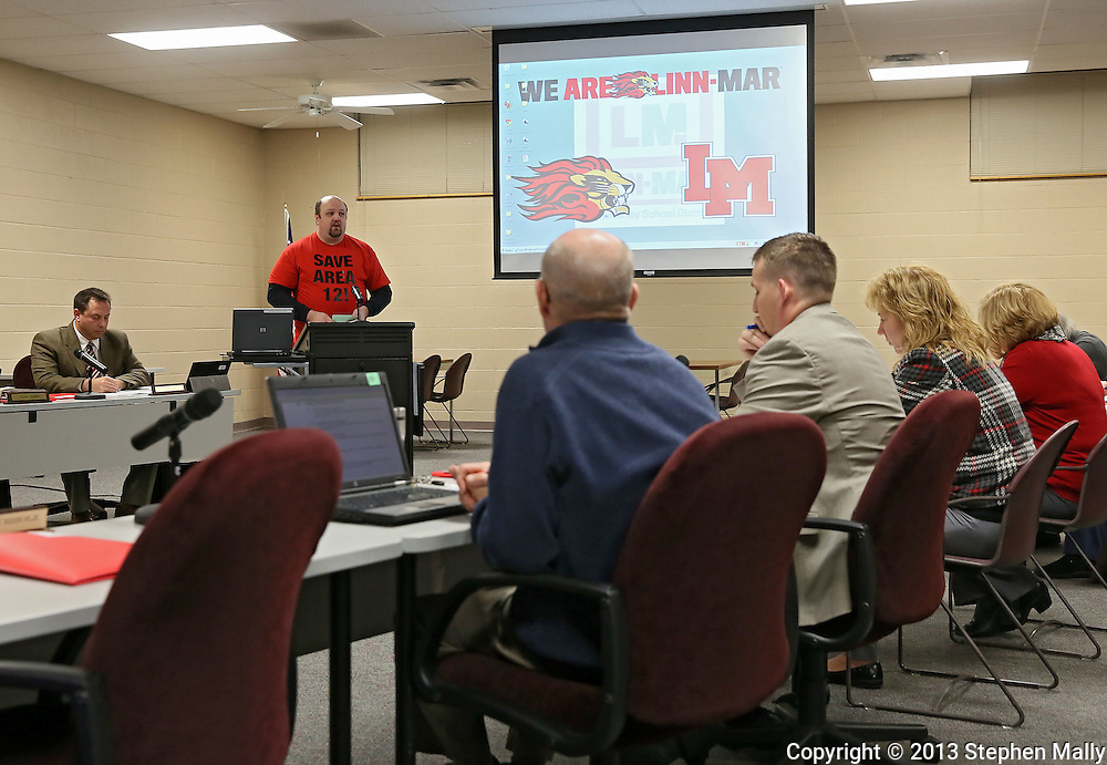 Michael Stoddard of Marion addresses the Linn-Mar Community School District Board of Education during a meeting at the Linn-Mar Learning Resource Center in Marion on December 9, 2013.