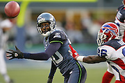 SEATTLE - NOVEMBER 28:  Recently acquired wide receiver Jerry Rice #80 of the Seattle Seahawks watches an incomplete pass while defended by safety Rashad Baker #26 of the Buffalo Bills at Qwest Field on November 28, 2004 in Seattle, Washington. The Bills defeated the Seahawks 38-9. ©Paul Anthony Spinelli *** Local Caption *** Jerry Rice; Rashad Baker