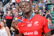 Close up of Saracens lock Maro Itoje (6) as he holds up his winners medal during the Gallagher Premiership Rugby Final match between Exeter Chiefs and Saracens at Twickenham, Richmond, United Kingdom on 1 June 2019.
