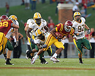 September 3, 2009: Iowa State quarterback Austen Arnaud (4) is pulled down by North Dakota State cornerback Derrius Colvin (32) during the first half of the Iowa State Cyclones' 34-17 win over the North Dakota State Bison at Jack Trice Stadium in Ames, Iowa on September 3, 2009.