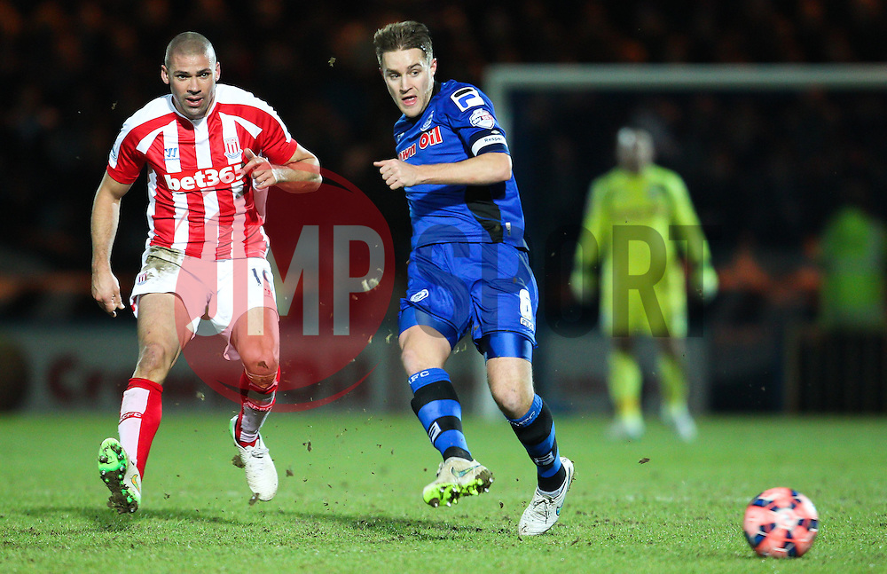 Rochdale's Oliver Lancashire and Stoke City's Jonathan Walters - Photo mandatory by-line: Matt McNulty/JMP - Mobile: 07966 386802 - 26/01/2015 - SPORT - Football - Rochdale - Spotland Stadium - Rochdale v Stoke City - FA Cup Fourth Round