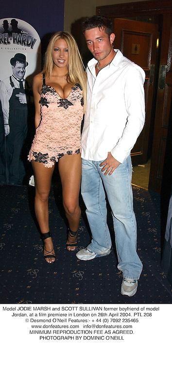 Model JODIE MARSH and SCOTT SULLIVAN former boyfriend of model Jordan, at a film premiere in London on 26th April 2004.PTL 208