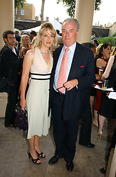 LORD & LADY BELL at the Tatler Summer Party 2006 in association with Fendi held at Home House, Portman Square, London W1 on 29th June 2006.<br />