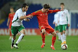 Harry Wilson of Wales U21s (Liverpool) is challenged by Georg Iliv of Bulgaria u21s  - Photo mandatory by-line: Dougie Allward/JMP - Mobile: 07966 386802 - 31/03/2015 - SPORT - Football - Cardiff - Cardiff City Stadium - Wales v Bulgaria - U21s International Friendly
