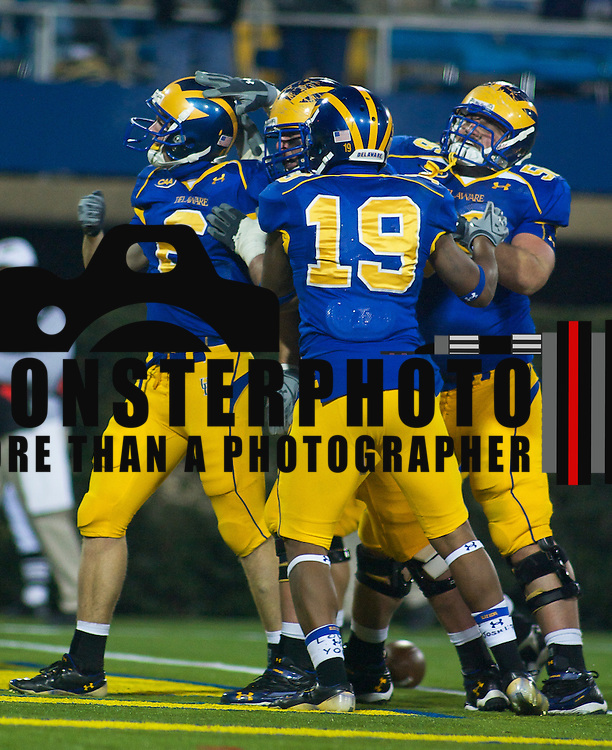 Delaware WR (#6) Mark Schenauer celebrates with teammates after a 9 yards TD with 13:04 left in the 4th quarter Delaware Leads UNH 16-3. No. 5 Delaware defeats No.11 New Hampshire 16-3 on a brisk Friday at Delaware stadium in Newark Delaware...Delaware will host the Division I FCS Championship Semifinals Round next weekend..