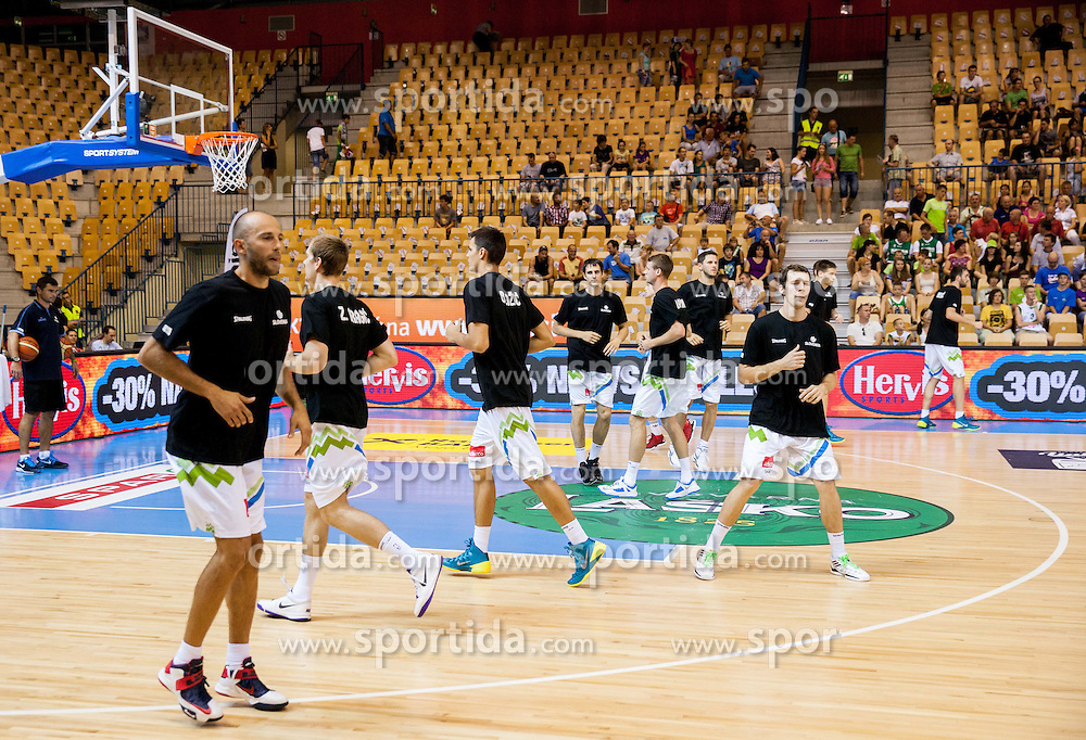 Players of Slovenia at warming up  during friendly match between National teams of Slovenia and Latvia for Eurobasket 2013 on August 2, 2013 in Arena Zlatorog, Celje, Slovenia. (Photo by Vid Ponikvar / Sportida.com)
