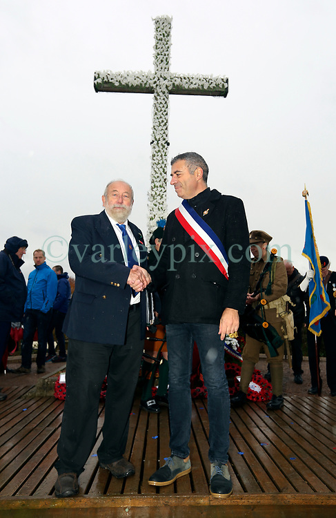 11 November 2018. Lochnagar Crater, La Boisselle, Somme, France. <br /> <br /> Richard Dunning MBE (left - event organiser and owner of the land) poses with Christian Bernard, the Mayor of La Bissell.<br /> <br /> Gathered in the pouring rain, those who perished in the Great War are remembered by British and French civilians on the 100th anniversary of the Great War. <br /> <br /> Lochnagar Crater was created by the Tunnelling Companies of the Royal Engineers under a German field fortification. The explosion was the loudest man made noise created at that time, purportedly heard in London. <br /> <br /> Photo©; Charlie Varley/varleypix.com