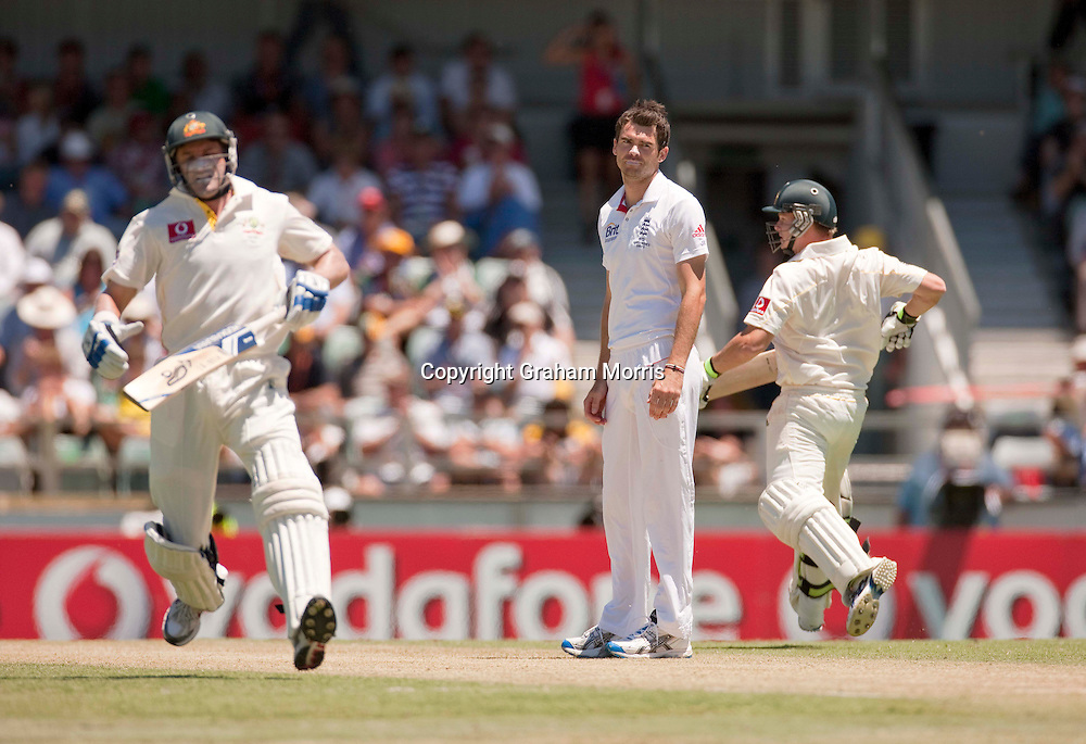 James Anderson down as Michael Hussey (left) and Steven Smith run off his bowling during the third Ashes test match between Australia and England at the WACA (West Australian Cricket Association) ground in Perth, Australia. Photo: Graham Morris (Tel: +44(0)20 8969 4192 Email: sales@cricketpix.com) 18/12/10