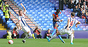 Wilfred Zaha with a low driven effort during the Barclays Premier League match between Crystal Palace and West Bromwich Albion at Selhurst Park, London, England on 3 October 2015. Photo by Michael Hulf.