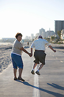 Senior couple on footpath along beach
