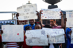 Students from Addelita Cancryn High School with signs for veterans.  Veteran's Day Parade and Program at the Frankliin Delano Roosevelt Memorial Park in Charlotte Amalie.  St. Thomas.  11 November 2013.  © Aisha-Zakiya Boyd