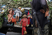 A Liberian government gunman stands in front of a government malitia vehicle adorned with superstitious dolls at a firing point above the 'New' bridge, Monrovia 04 August 2003. Fighting continued at the bridges despite the arrival of peacekeepers at the airport. The first wave of ECOWAS peacekeepers and food and medical aid arrivided at Liberias Robertson international airport today.<br /> EPA PHOTO/NIC BOTHMA