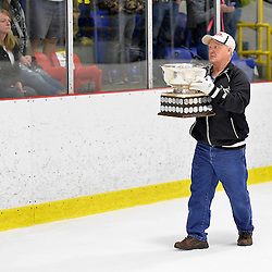FORT FRANCES, ON - May 2, 2015 : Central Canadian Junior &quot;A&quot; Championship, game action between the Fort Frances Lakers and the Soo Thunderbirds, Championship game of the Dudley Hewitt Cup.  The Dudley Hewitt Cup makes its way to centre ice for the presentation.<br /> (Photo by Shawn Muir / OJHL Images)