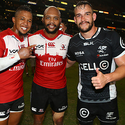 DURBAN, SOUTH AFRICA - APRIL 09: (L)  Elton Jantjies of the Emirates Lions (R) Lionel Mapoe of the Emirates Lions and Keegan Daniel of the Cell C Sharks during the 2016 Super Rugby match between Cell C Sharks and Emirates Lions at Growthpoint Kings Park on April 09, 2016 in Durban, South Africa. (Photo by Steve Haag/Gallo Images)