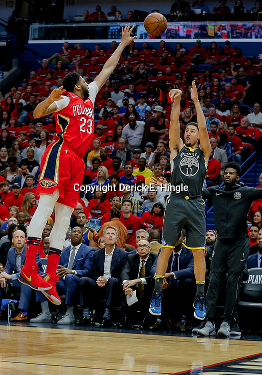 May 6, 2018; New Orleans, LA, USA; Golden State Warriors guard Klay Thompson (11) shoots oer New Orleans Pelicans forward Anthony Davis (23) during the first quarter in game four of the second round of the 2018 NBA Playoffs at the Smoothie King Center. Mandatory Credit: Derick E. Hingle-USA TODAY Sports