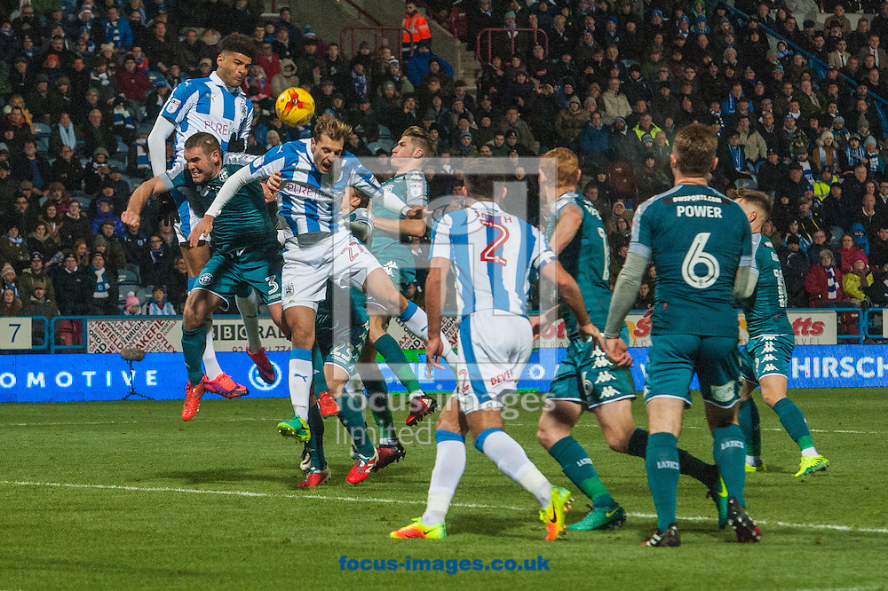 Jon Gorenc Stankovic of Huddersfield Town gets his head to the ball during a goalmouth scramble during the Sky Bet Championship match at the John Smiths Stadium, Huddersfield<br /> Picture by Matt Wilkinson/Focus Images Ltd 07814 960751<br /> 28/11/2016