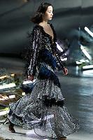 Xiao Wen Ju (IMG New York) walks the runway wearing Rodarte Fall 2015 during Mercedes-Benz Fashion Week in New York on February 17, 2015
