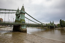 © Licensed to London News Pictures. 14/08/2020. London, UK. Hammersmith Bridge which crosses the River Thames in West London lays empty after Fulham Council suddenly closed it to all traffic Thursday night due to safety concerns. Hammersmith Bridge has been close to all traffic including pedestrians, cyclists and boats going under it after cracks in the bridge have become larger by the heatwave. Photo credit: Alex Lentati/LNP
