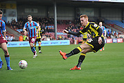 Burton Albion defender Tom Naylor (15) takes a close range shot at goal during the Sky Bet League 1 match between Scunthorpe United and Burton Albion at Glanford Park, Scunthorpe, England on 9 April 2016. Photo by Ian Lyall.