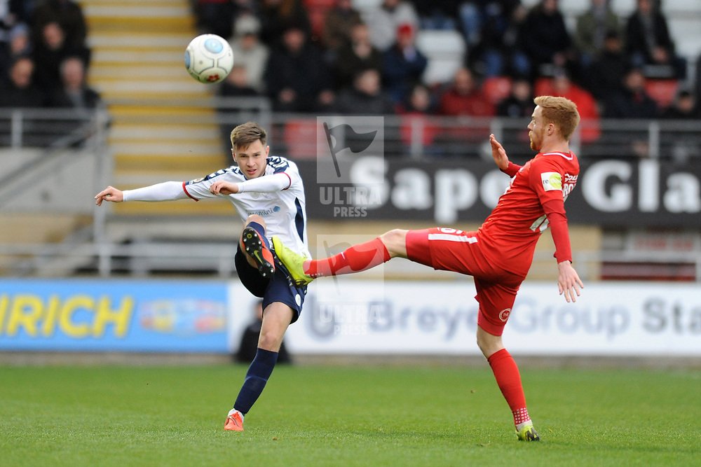 TELFORD COPYRIGHT MIKE SHERIDAN 16/3/2019 - Ryan Barnett of AFC Telford (on loan from Shrewsbury Town Football Club) clears under pressure from James Brophy of Orient during the FA Trophy semi final first leg fixture between Leyton Orient and AFC Telford United at Brisbane Road.