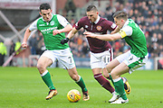David Milinkovic under pressure from John McGinn and Paul Hanlon during the William Hill Scottish Cup 4th round match between Heart of Midlothian and Hibernian at Tynecastle Stadium, Gorgie, Scotland on 21 January 2018. Photo by Kevin Murray.