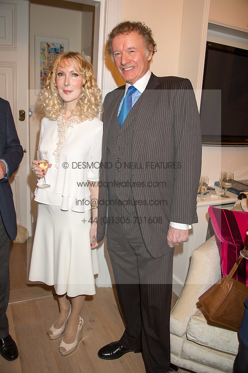 RICHARD & BASIA BRIGGS at a reception to celebrate the publication of Quicksilver by HRH Princess Michael of Kent held at the home of Richard & Basia Briggs, 35 Sloane Gardens, London on 9th November 2015.