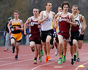 Evan Feigel of Pittsford Mendon leads the second heat of the boys 1,600-meter run at the His and Her track and field invitational at Penfield High School on Saturday, April 26, 2014.