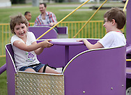Holly Pregon (from left), 7, and Joey Pregon, 9, both of Cedar Rapids enjoy one of the rides at the 21st annual Tanager Place Summer Fest at the Rockwell Collins Sports Complex in Cedar Rapids on Saturday afternoon, June 4, 2011. Activities included the General Mills Make-Your-Own Cereal Tent, miniature golf, St. Luke's Hospital bike helmet giveaway, Video Game Etc tent, forty free kids' crafts and displays, a car show, and music. All proceeds from the event went to Tanager Place.