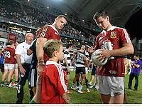 1 June 2013; Jonathan Sexton, alongside team-mate Jamie Heaslip, British & Irish Lions, signs an autograph for Odhran Neville, age 8, from Co. Wexford, following their side's victory. British & Irish Lions Tour 2013, Barbarians v British & Irish Lions, Hong Kong Stadium, So Kon Poh, Hong Kong, China. Picture credit: Stephen McCarthy / SPORTSFILE