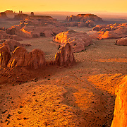 View from Hunt's Mesa overlooking Monument Valley at sunset.