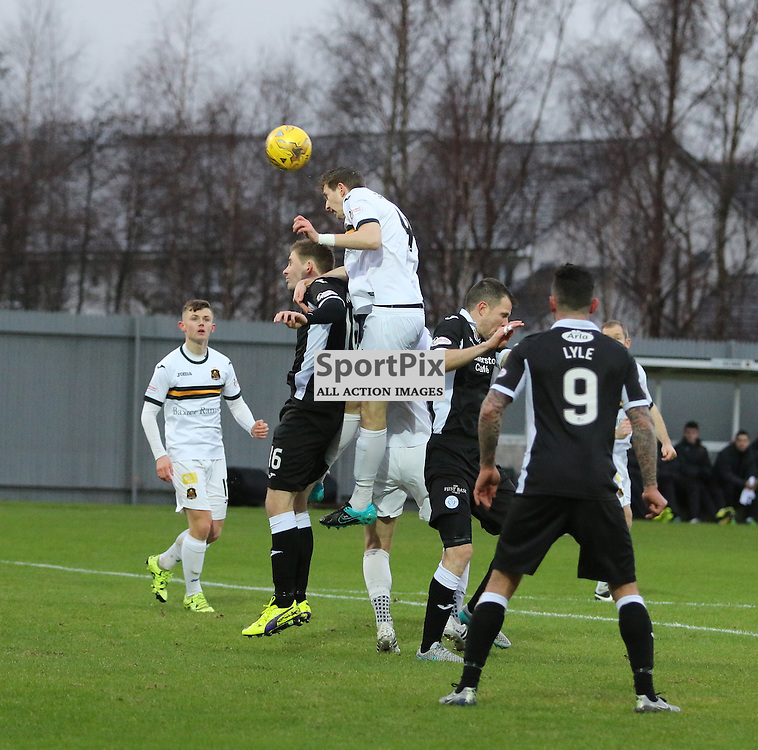 Steven Saunders heads for goal  during the Dumbarton v Queen of the South  Scottish Cup 4th Round  09 January 2016<br /> <br /> (c) Andy Scott | SportPix.org.uk