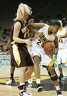 25 JANUARY 2007: Iowa forward Jenee Graham (24) tries to hang onto a rebound while being guarded by Minnesota guard Emily Fox (4) in Iowa's 80-78 overtime loss to Minnesota at Carver-Hawkeye Arena in Iowa City, Iowa on January 25, 2007.