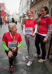 Rajko Kenda, ambasador of Mercator Izziv, Mateja Funtek Derca  and Petra Robnik  during 16th International Ljubljana Marathon 2011 on October 23, 2011, in Trg republike, Ljubljana, Slovenia.  (Photo by Vid Ponikvar / Sportida)