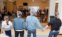 """Sarah Dan Jones sings """"We Shall Overcome"""" as the audience joined hands and sang along at the conclusion of the Martin Luther King Celebration at Laconia Middle School Sunday evening.  (Karen Bobotas/for the Laconia Daily Sun)"""
