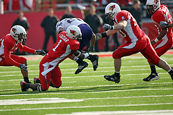 27 October 2007: Alex Douglas leaps but can't avoid the grasp of Jesse Caesar. The Western Illinois Leathernecks beat up on the Illinois State Redbirds  27-14 at Hancock Stadium on the campus of Illinois State University in Normal Illinois.
