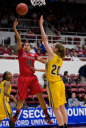 March 20, 2010; Stanford, CA, USA; Rutgers Scarlet Knights guard Nikki Speed (11) shoots over Iowa Hawkeyes forward Kelly Krei (20) during the first half in the first round of the 2010 NCAA womens basketball tournament at Maples Pavilion. Iowa defeated Rutgers 70-63.