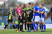 Bury players surround Ref Mr Banks following foul by Niall Maher during the EFL Sky Bet League 1 match between Rochdale and Bury at Spotland, Rochdale, England on 15 October 2016. Photo by Daniel Youngs.