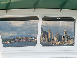 United States, Washington, Seattle, downtown skyline reflected in ferry window