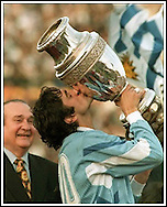 Uruguayan player Enzo Fancescoli holds up and kiss the trophy after winning the Copa America final match against Brazil, on 23 July 1995, at Centenario Stadium, in Montevideo, Uruguay.  (Alejandro Pagni/AFP)
