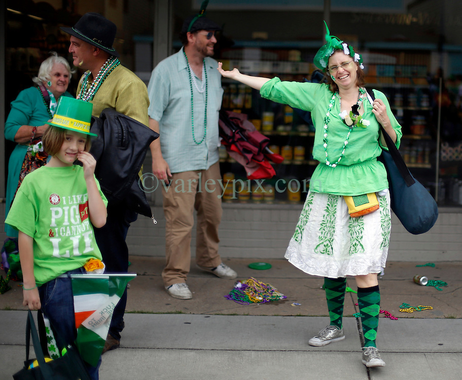 12 March 2016. New Orleans, Louisiana.<br /> Amy George-Hirons at the Irish Channel St Patrick's Day parade as the procession makes its way along Magazine Street.<br /> Photo©; Charlie Varley/varleypix.com