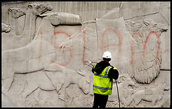 The Clean-up operation begins at war memorials defaced with Islamic slogans in London. The word 'Islam' is removed from the Animals In War memorial in Park Lane, London, after a spate of ugly attacks in the wake of soldier Lee Rigby's murder.Tuesday, 28th May 2013.Picture by Andrew Parsons / i-Images