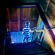 A young boy explores below deck on the TSS Earnslaw, the 100 year old vintage coal fired passenger steam ship which sails on Lake Wakatipu, Queenstown, New Zealand. The popular tourist attraction is celebrating it's centenary year with celebrations planned for October 2012.  Queenstown, Central Otago, New Zealand. 29th February 2012. Photo Tim Clayton