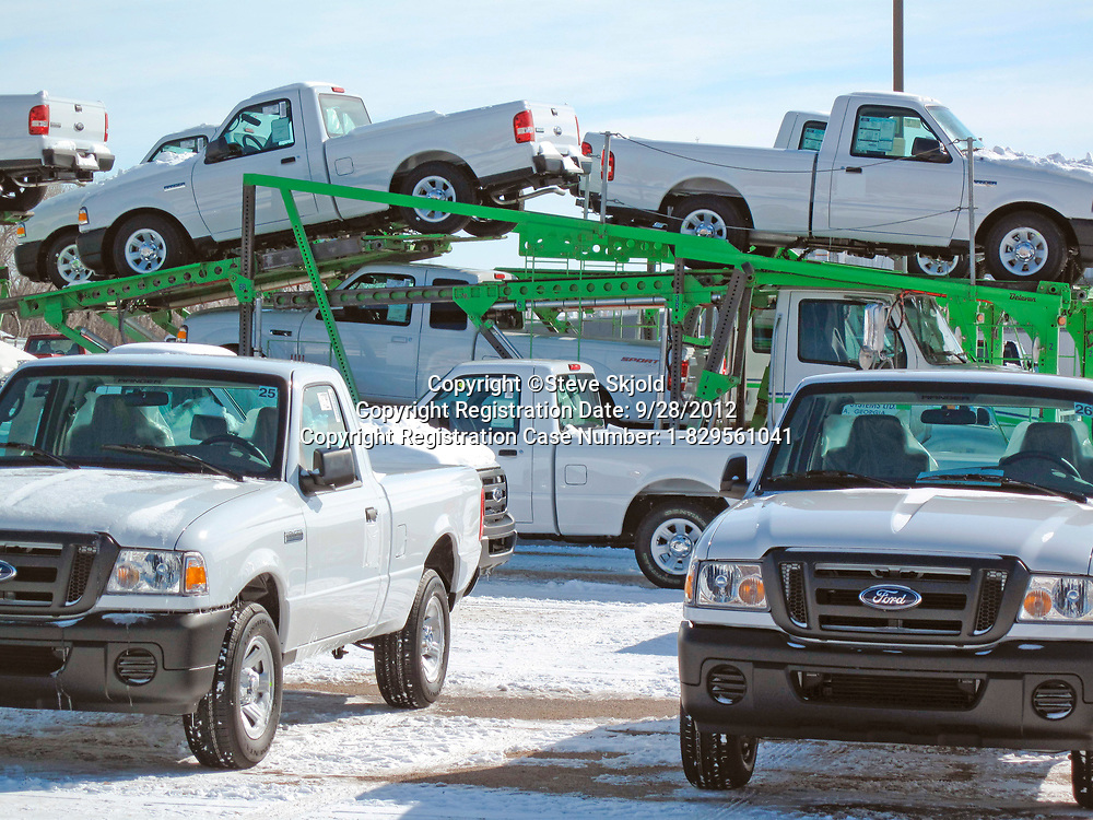 Ford Ranger pickup trucks on a carrier at the doomed assembly plant to be closed in 2012. St Paul Minnesota MN USA