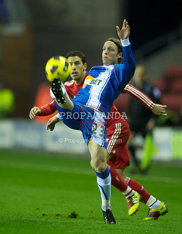 WIGAN, ENGLAND - Wednesday, November 10, 2010: Liverpool's Maximiliano Ruben Maxi Rodriguez and Wigan Athletic's Ronnie Stam during the Premiership match at the DW Stadium. (Photo by David Rawcliffe/Propaganda)