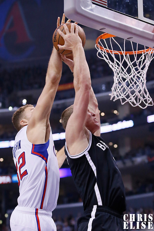 16 November 2013: Los Angeles Clippers power forward Blake Griffin (32) blocks Brooklyn Nets power forward Mason Plumlee (1) during the Los Angeles Clippers 110-103 victory over the Brooklyn Nets at the Staples Center, Los Angeles, California, USA.