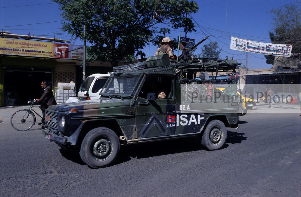 Kabul, 20 July 2005..ISAF Danish  troops, on board of a military  vehicle, patrolling the street of the Afghan's capital.