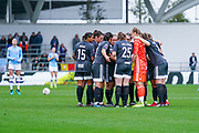 Birmingham City Women players huddle before the second half during the FA Women's Super League match between Manchester City Women and BIrmingham City Women at the Sport City Academy Stadium, Manchester, United Kingdom on 12 October 2019.