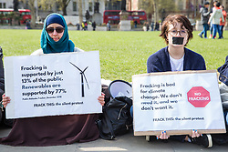 London, UK. 14th April 2019. Young anti-fracking campaigners from UK Youth Climate Coalition (UKYCC) hold a silent protest in Parliament Square to repeat their request for a meeting with Minister for Energy and Clean Growth Claire Perry, to highlight how young people's voices are marginalised and to call on the Government to ban fracking.